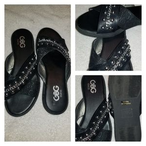 Black flat sandals with silver